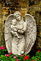 Angelic angel with child sculpture in prayer garden vertical