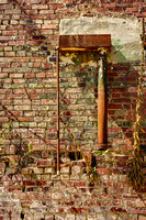 Extrerior rusty metal pipe brick wall