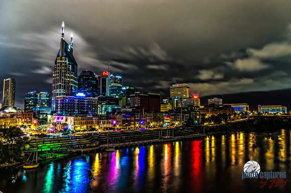 Reflections in water riverfront Music City Nashville cloudy sky