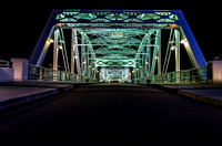 Green glow of lighted John Seigenthaler Pedestrian Bridge