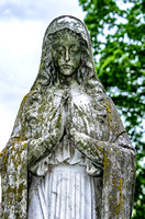 Calvary Catholic Cemetery female sculpture hands togetehr in prayer