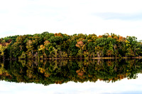 Colorful foliage reflected in Couchville Lake Long Hunter State Park