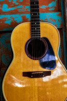 Acoustic guitar haning on rustic antique door