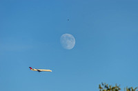 Airliner flying past moon