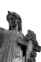 Black and White Weathered Female Sculpture Holding Cross