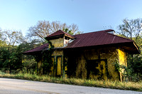 Abandoned old yellow McKnight Station Train Depot on edge of Leipers Creek Road
