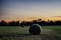 Sunset over rolls of hay in field in rural Franklin TN