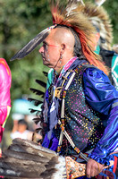 Colorful attire on senior male dancer NAIA Powwow
