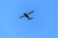 Small Cessna flying high into the blue sky