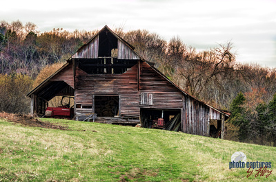 Old Tractor Hidden Away In Old Barn On Farm Middle TN