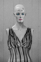 Modern classic dress on antique mannequin