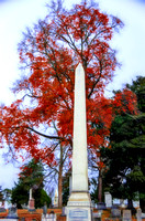 Obelisk in front of colorful Fall Tree