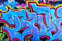 Blue with pink highlights graffiti