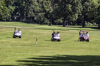 Three golf carts with golfers West Nashville golf course