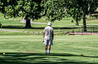 Mature golfer watching to see where his ball lands West Nashville Golf Course