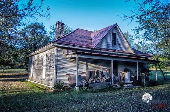 Abandoned old white house with red metal roof rural Sante Fe TN