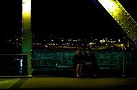 Elegant couple on date night on John Seigenthaler Pedestrian Bridge