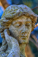 Hand to ear female sculpture Mount Olivet Cemetery