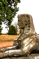Sphinx sculpture resting monument
