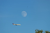 Moon above airliner