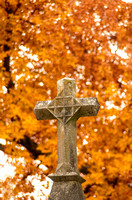 Stone of Cross in front of Orange Fall Leaves